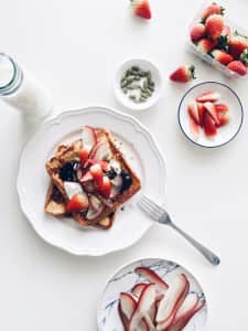 Breakfast : French toast with strawberries, rose apple, pumpkin seeds, blueberry jam and yogurt.