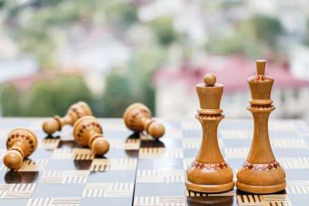 Chessboard with figures on a blurred background, chess, game, closeup, strategy, competition, chessboard, hand, intelligence, victory, success, concept, play, battle, business, detail, fight, decision, match, wooden, board, defeat, check, conflict, challenge, king, piece, move, power, sport, think, mate, object, solution, hobby, politics, conquering, war, battlefield, checkmate, strategic, figure, background, player, risk, tournament, leadership, plan, nobody, no people, copy space