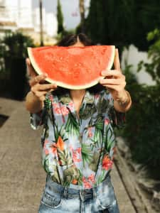 Girl holding a slice of watermelon