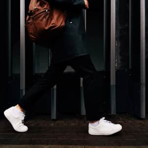 Man in a white sneakers walking on the street