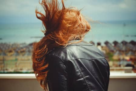Healthy ginger hair in a windy and sunny day.