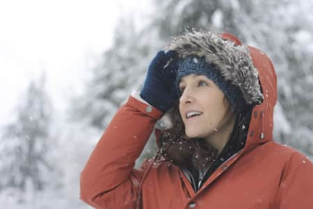 A woman marvels at falling snow