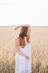 Elegant woman stretching in the field