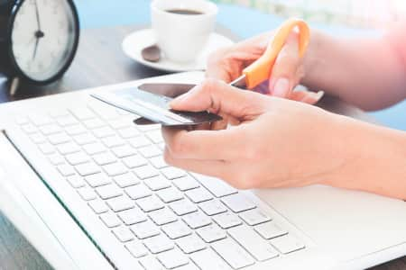 Woman cutting credit card, Online shopping concept