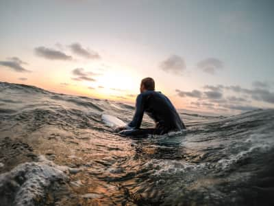 Surfing at the sunset