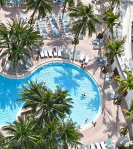 Swimming pool at resort from above