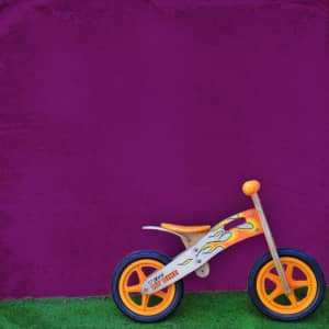 training wheels against purple wall