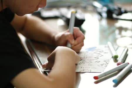 Young teenage girl drawing paper coloring relax at home.