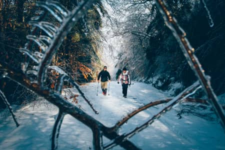 Mother and Son enjoying a Winter hike in Mt Kearsarge State Forest, NH.