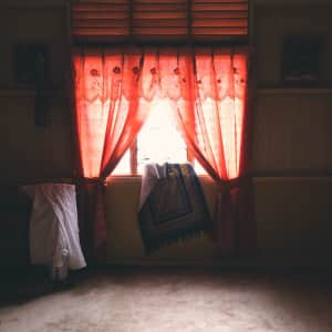 Sajjada. Surreal lighting over Muslim prayer space in small house at Malacca, Malaysia.
