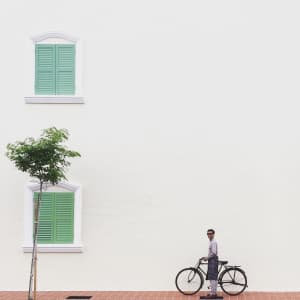 People with bicycle at the minimal wall