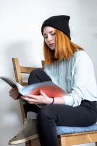 Red-haired girl leafing through a magazine