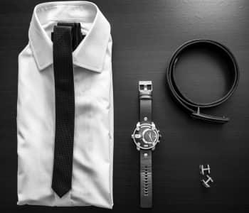 Men's formal wear with accessories in black and white