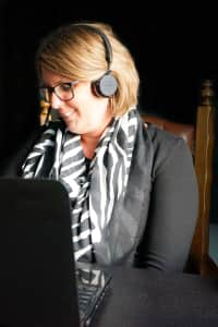 A working woman with a headphone