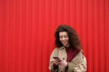 Smiling woman using mobile device