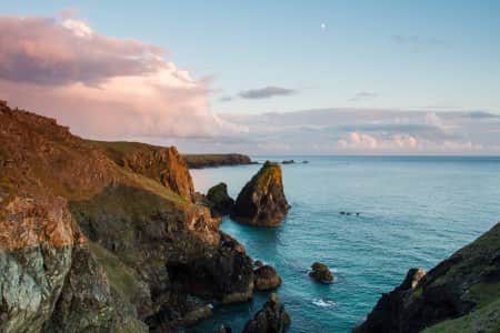 A Seaview of Kynance Cove in Cornwall UK showing harsh rocks and rugged cliffs in a coastal panoramic image at sunset •NOMINATED•