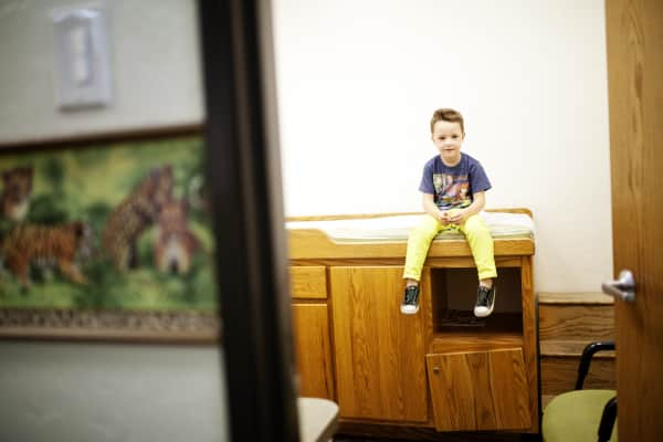 boy waiting in a doctors office