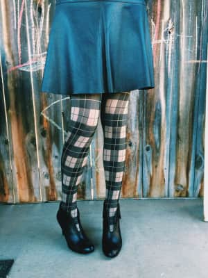 Plaid tights and leather skirt