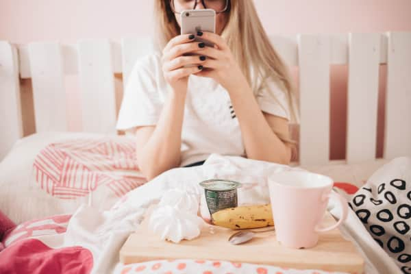 Girl using mobile in bed