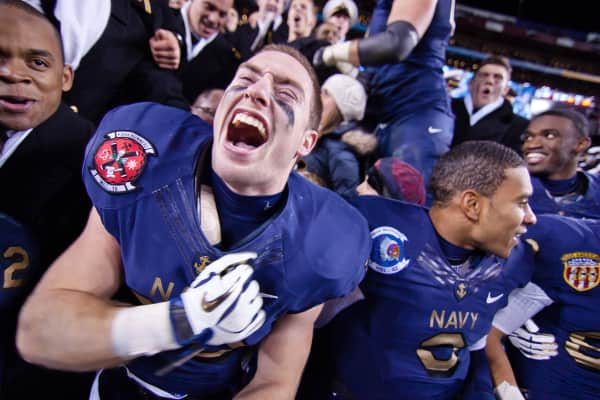 Navy Running Back John Howell (33) screams in celebration with his Navy teammates and fans after Navy defeated Army 27-21 n front of 82,000 Saturday, Dec. 10, 2011 at Fed EX field in Landover Md.