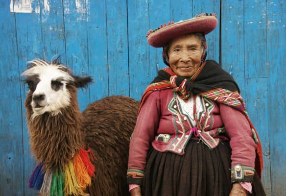 Quechua woman and her llama.
