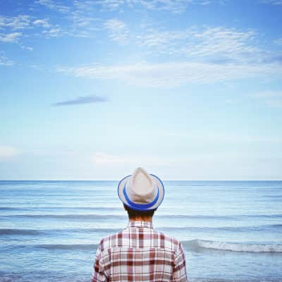 A man stand alone by the sea
