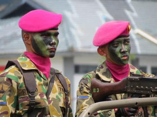 Two fully dressed Marines in the Indonesian Marines Anniversary Parade