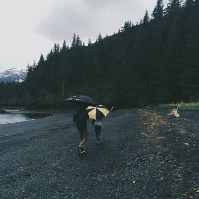 Walking on the beach, on a rainy day.