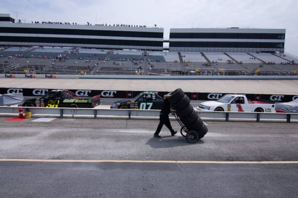 05/13/11 Dover, DE: A Pit crew member moves a sets of tires to a waiting moving truck after a regular season NASCAR Camping World Truck Series race at Dover International Speedway in Dover Delaware.