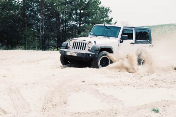 Jeep drifting in sand