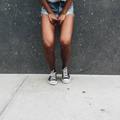 Converse and high waisted shorts.