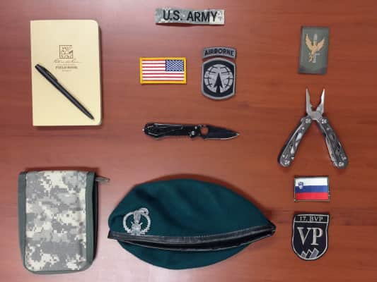 The world traveled, friendships made, bonds forged. Tools and insignias of the US Army and Allied Forces; Dutch Marines and Slovenian Army.