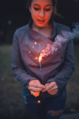 Playing with sparklers in the backyard...they didn't work well