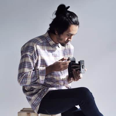 Man held a vintage camera with style