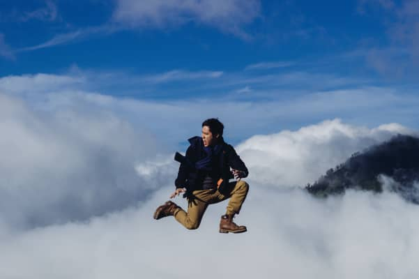 Man jumping on cloud