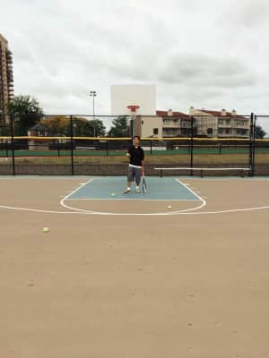 Playing tennis on a basketball court - of course with no net