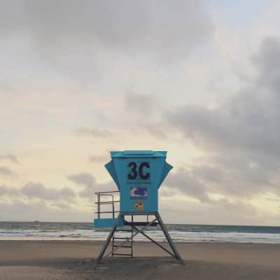 Lifeguard stand at dusk during the start of a summer storm.