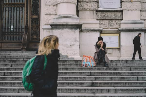 Woman sitting on the stairs talking on the phone