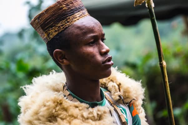 A Kenyan dressed in traditional attire attends a village dance.