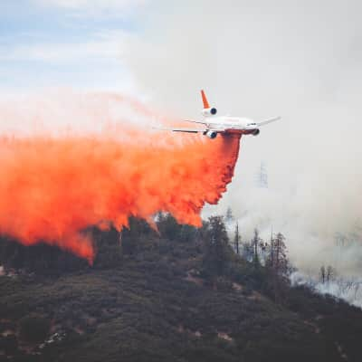The California Wildfires rage on as the largest air tanker drops retardant on the flames.