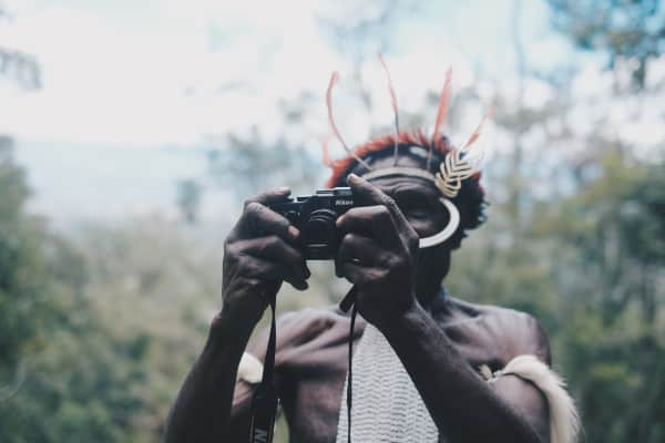 From the heart of Papua Island: A man of Dani Tribe for the first time touch a camera.