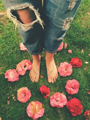 Hole-y jeans and faded flowers