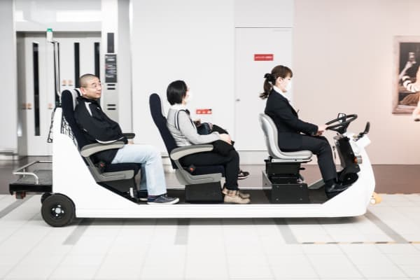 People on cart in airport