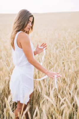 Woman touching golden fields