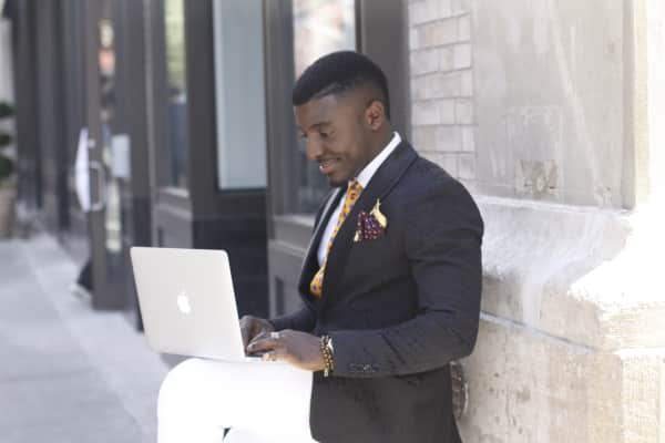 Startups & Working in Tech / Using Computer / New York Life  Business; Business People; Young Professional; Beautiful and Black; Great Guys; Professionally Dressed.