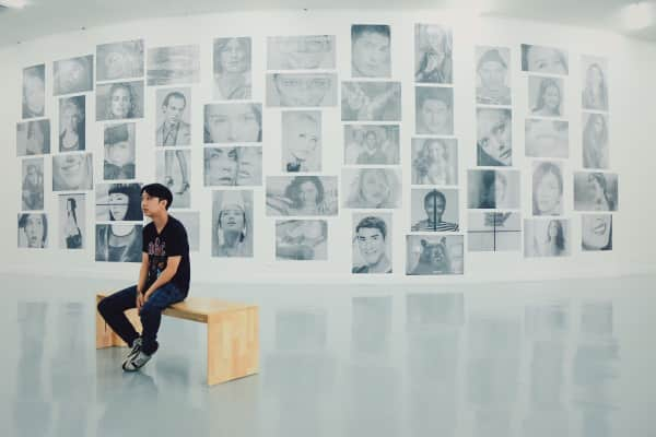 A man and the art exhibition in the gallery
