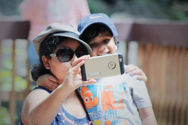 Young mom and son Selfie - snapping picture from mobile device