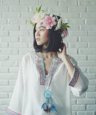 Woman dressed in bohemian style | flower crown | dream catcher
