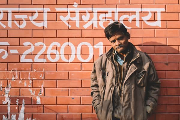 Indian man on the brick wall