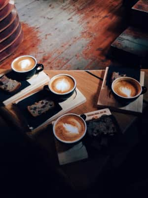 Cups of coffee on the wooden table